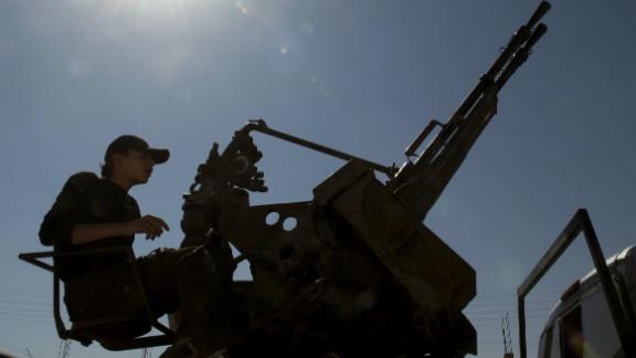 A Syrian rebel mans a  machine gun near Al-Bab, northeast of Syria