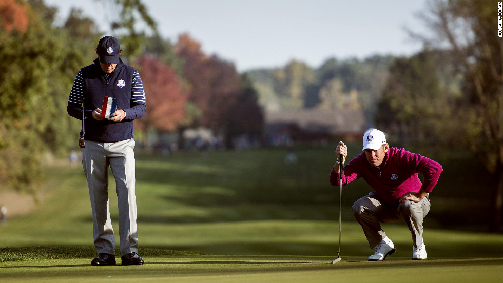 Team USA's Phil Mickelson, left, and Team Europe's Lee Westwood of England study the fifth green during a morning foursomes match on Saturday.