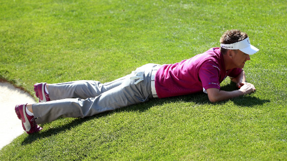 Ian Poulter of Europe lines up a putt on the 16th green on Saturday.