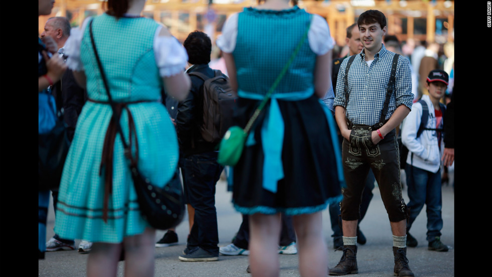 People dressed in traditional Bavarian clothing attend the beer festival.