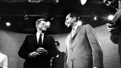Candidates John F. Kennedy, left, and Richard Nixon exchange smiles ahead of their first TV debate.