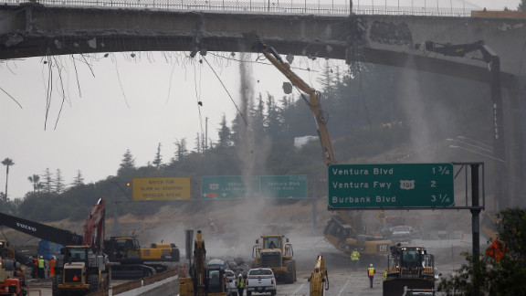 """Workers demolish the south side of Mulholland overpass on the 405 freeway during last year's """"Carmageddon."""""""
