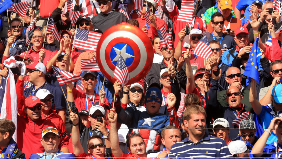Team USA fans cheer from the stands Sunday.