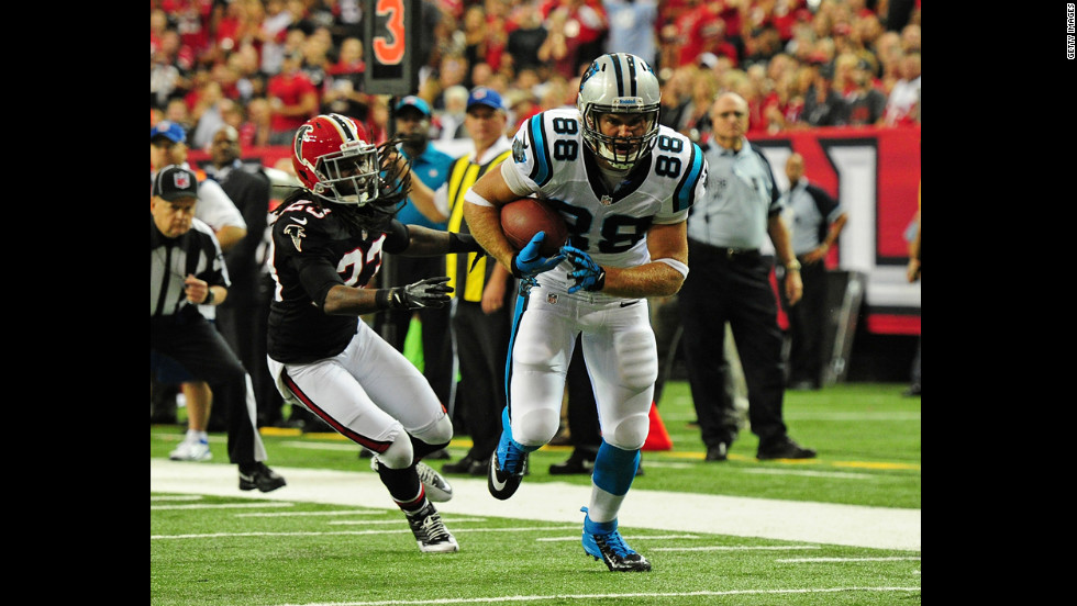 Greg Olsen of the Carolina Panthers makes a catch and runs for a touchdown against the Atlanta Falcons on Sunday.