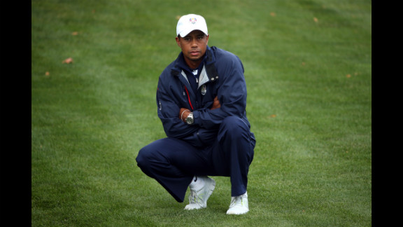 Tiger Woods of the United States watches from the fairway on the first hole Sunday.