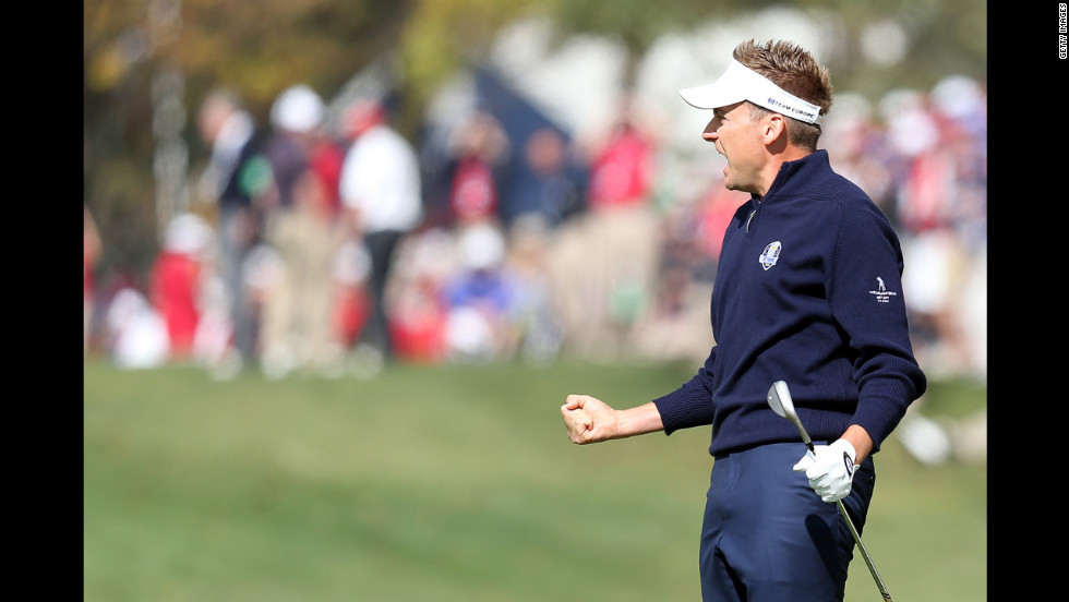 Ian Poulter of Europe celebrates after making a birdie on the first hole Sunday.