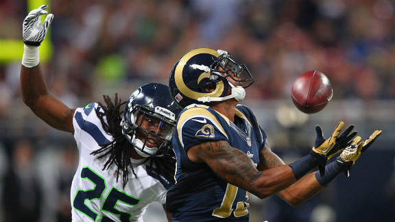 Chris Givens of the St. Louis Rams makes a catch against Richard Sherman of the Seattle Seahawks at Edward Jones Dome in St. Louis on Sunday.