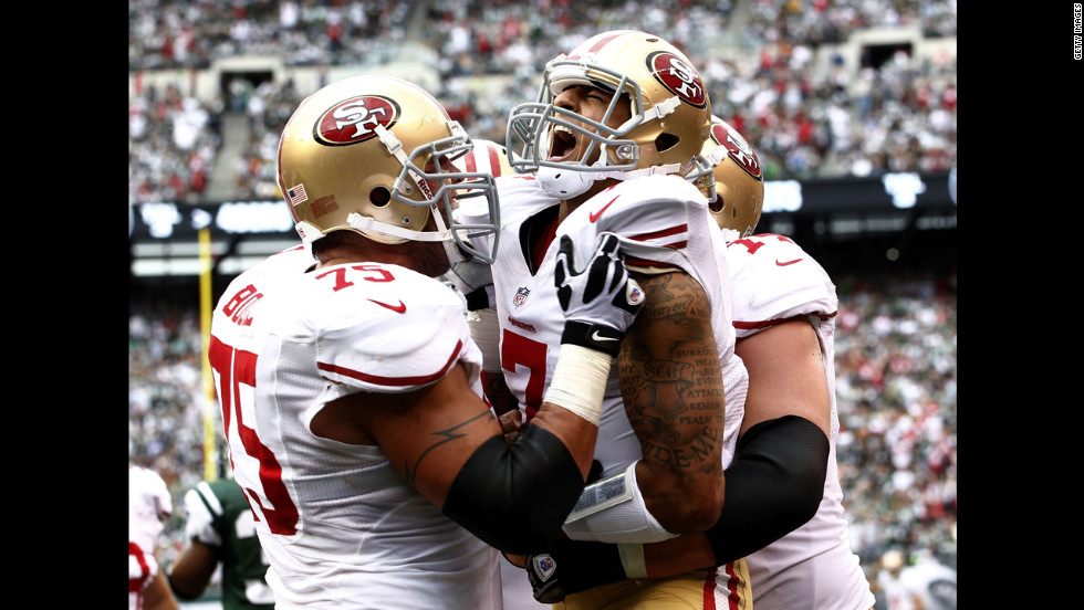 No. 7 Colin Kaepernick of the San Fransisco 49ers celebrates a touchdown with teammates Alex Boone, left, and Joe Staley during Sunday's game against the New York Jets.