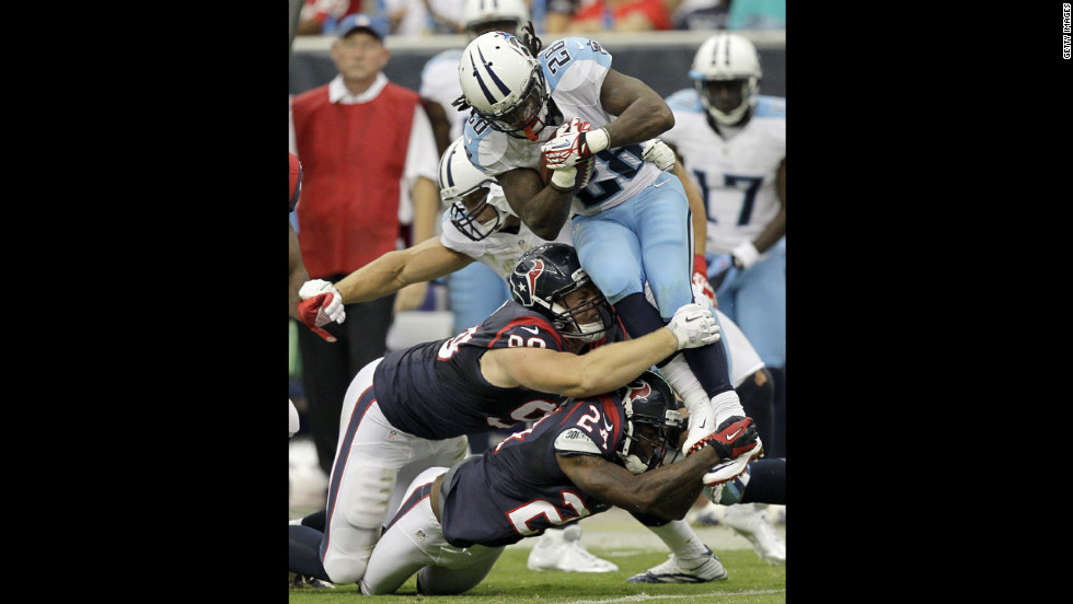 Chris Johnson of the Tennessee Titans is tackled during Sunday's game against the Houston Texans.