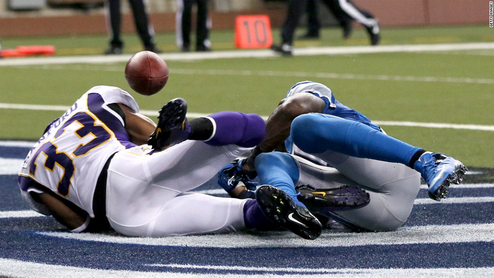Calvin Johnson of the Detroit Lions, right, drops the ball in the end zone after a tackle by Jamarca Sanford of the Minnesota Vikings on Sunday.