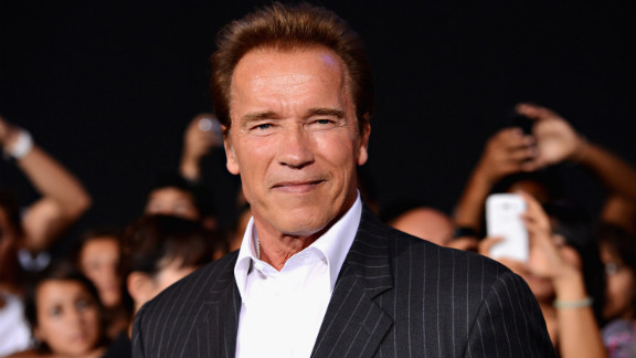 """Arnold Schwarzenegger arrives at """"The Expendables 2"""" premiere in August 2012."""