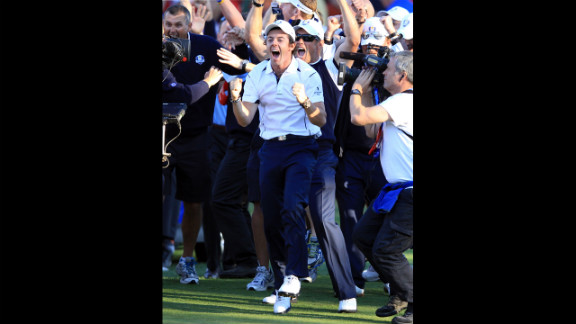Rory McIlroy of Europe celebrates after Martin Kaymer sinks his putt on the 18th green Sunday.