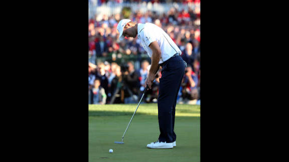 Martin Kaymer putts on the final hole Sunday to secure Europe
