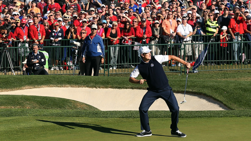 Justin Rose of Europe celebrates a birdie putt on the 18th green to defeat Phil Mickelson on Sunday.