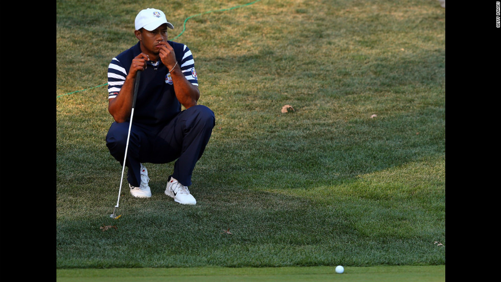 Tiger Woods waits on a hole during Sunday's singles matches.