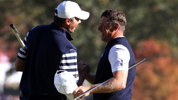 Lee Westwood of Europe, left, shakes hands with Matt Kuchar on the 16th green after defeating him Sunday.