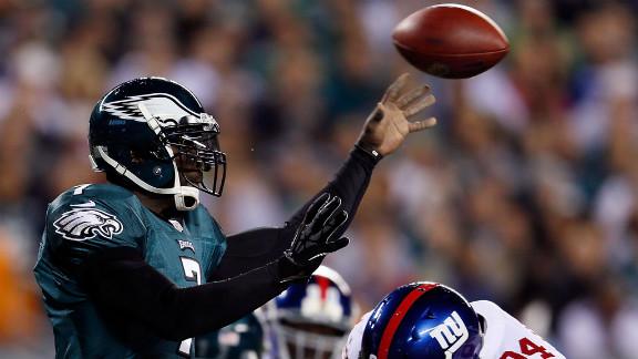 Eagles quarterback Michael Vick is tackled by Giants linebacker Mathias Kiwanuka on Sunday.