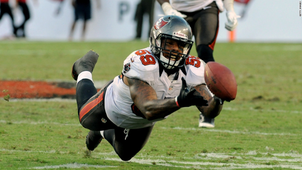 Quincy Black of the Tampa Bay Buccaneers dives for a deflected pass during Sunday's game against the Washington Redskins.