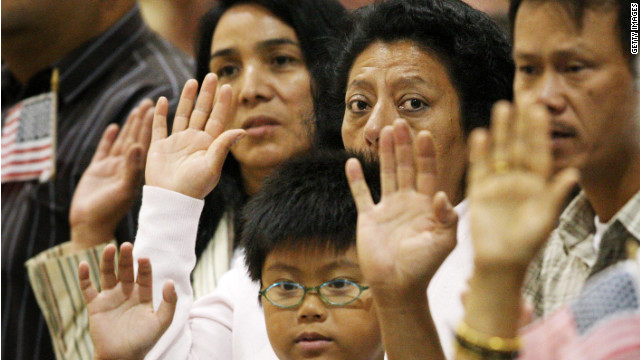 Latinos take the oath of citizenship during naturalization ceremonies at the Los Angeles Convention Center in 2008. Their numbers growing, Latino voters have growing influence in U.S. elections.