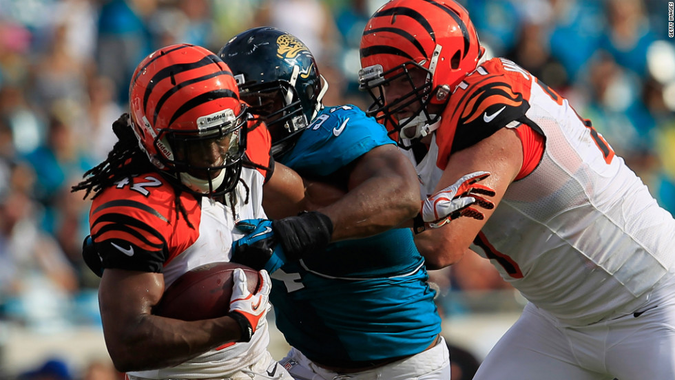 BenJarvus Green-Ellis of the Cincinnati Bengals is tackled by Jeremy Mincey of the Jacksonville Jaguars on Sunday.