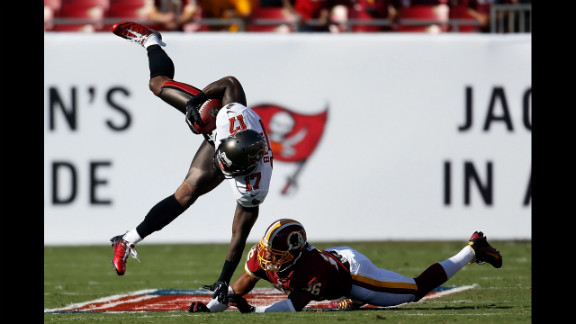 Josh Wilson of the Washington Redskins hits receiver Arrelious Benn of the Tampa Bay Buccaneers on Sunday.