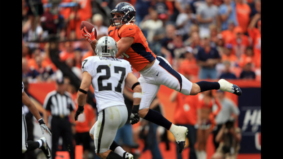 Joel Dreessen of the Denver Broncos catches a 22-yard touchdown pass in the first quarter Sunday against the Oakland Raiders.