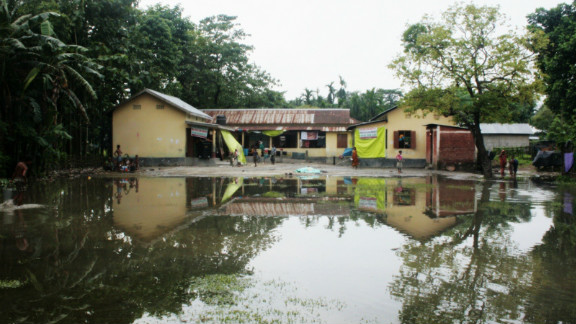 Most of the estimated 300,000 people displaced by the July riots are living in makeshift relief camps in schools. As a result, the start of the academic year has been cancelled for tens of thousands of students.  Here at an emergency relief camp in a school in Kokrajhar district, residents have to wade through a 40-feet wide puddle to access their home.