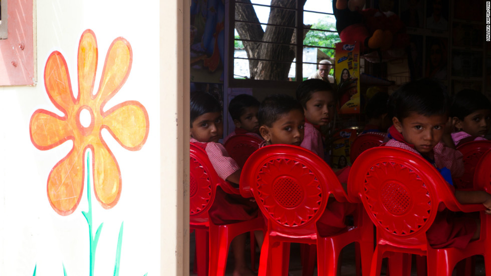 Children eat their morning meals at an anganwadi center, which also provides basic education and health care.