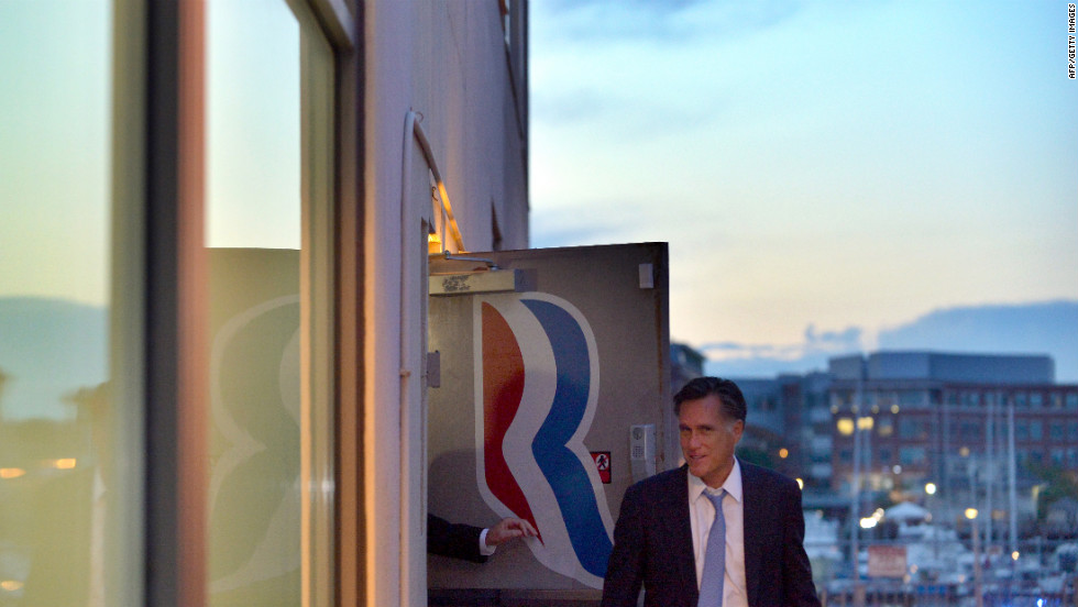 Romney leaves his campaign headquarters in Boston on Sunday.