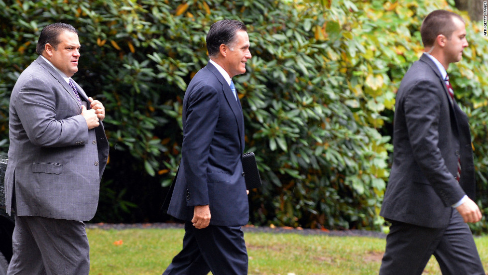 Romney arrives at the Church of Jesus Christ of Latter-day Saints in Belmont to attend Sunday services.
