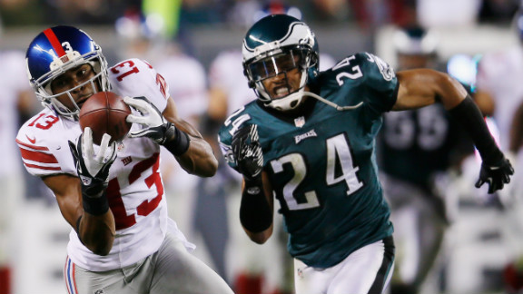 Giants wide receiver Ramses Barden catches a pass in front of Eagles cornerback Nnamdi Asomugha.