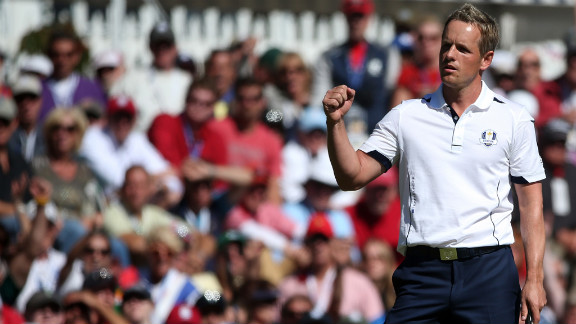 Luke Donald of Europe celebrates after saving bogey Sunday on the 13th green.