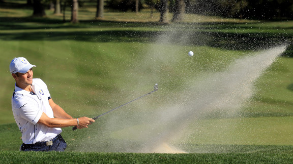 Martin Kaymer of Europe plays a bunker shot on the ninth hole Sunday.
