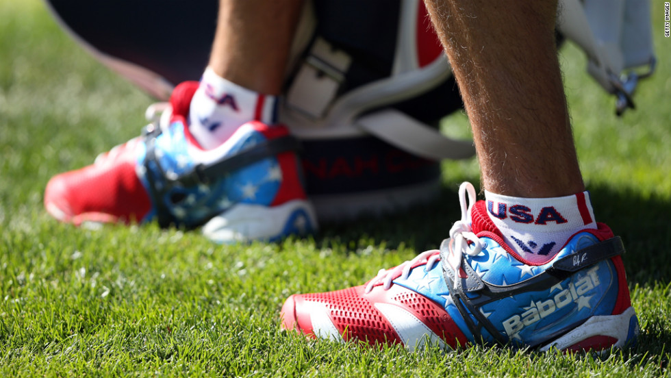 A U.S. team caddie wears patriotic shoes on Sunday.