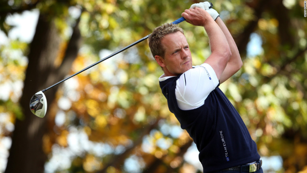 Luke Donald of Europe watches his tee shot on the third hole Sunday.