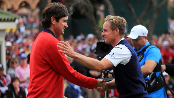 Bubba Watson of the United States, left, greets Luke Donald of Europe on the first tee Sunday in Medinah.