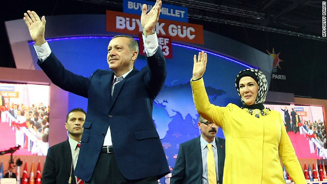 Turkish Prime Minister Recep Tayyip Erdogan and his wife Emine salute the audience during a congress of his party on Sunday.