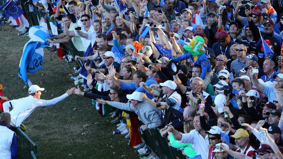 Nicolas Colsaerts, left, celebrates with fans after Europe beat the United States on Sunday. The biennial competition pits the best pro golfers from the United States against their European counterparts.