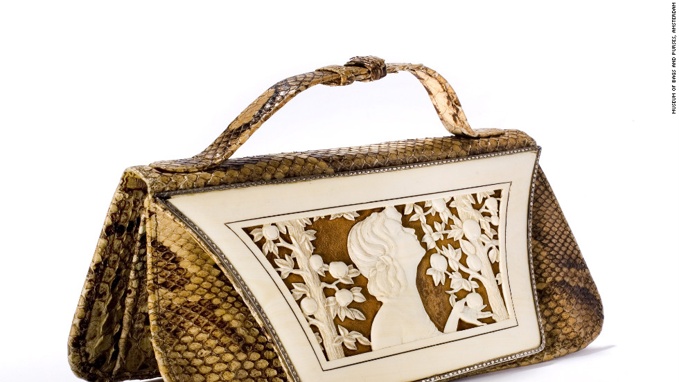 "This German-designed snakeskin handbag from the 1920s features an ivory ""cover sheet"" depicting the biblical Eve with the proverbial apple."