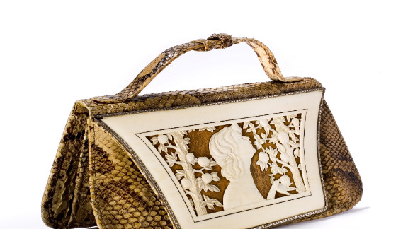 """This German-designed snakeskin handbag from the 1920s features an ivory """"cover sheet"""" depicting the biblical Eve with the proverbial apple."""