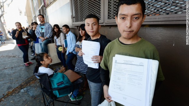 Immigrants who came to the U.S. as children line up in August to file deferral applications at an office in Los Angeles.