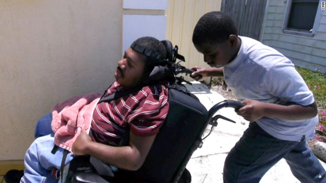 Terrell Termidor, 13, has to help care for his paralyzed brother, Emanuel, while their single mother works a full-time job.