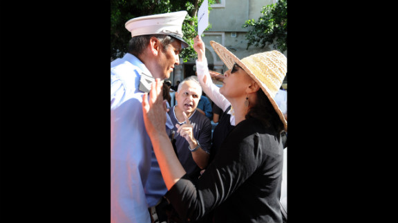 A Tunisian protester talks to a police officer during Tuesday