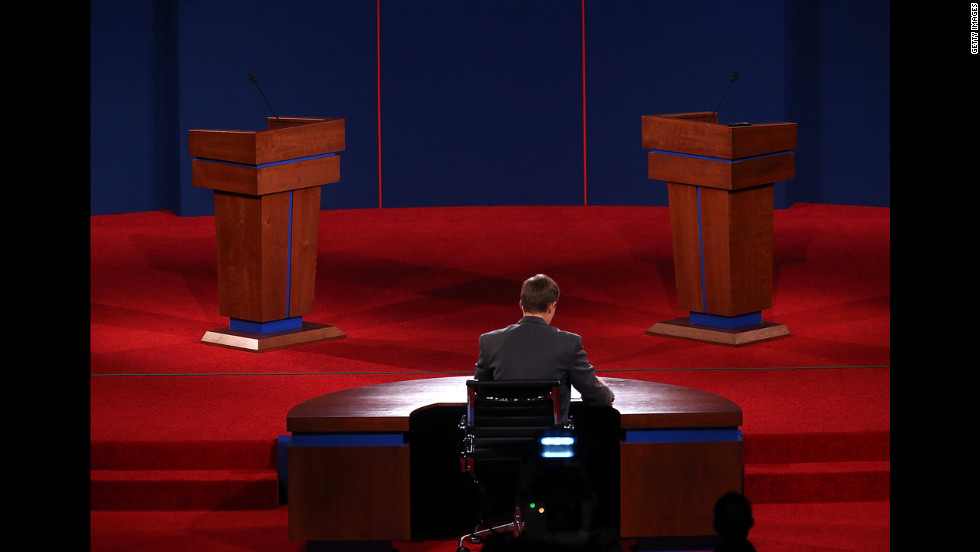 University of Denver student Sam Garry sits at the moderator's desk before a presidential debate dress rehearsal Tuesday.