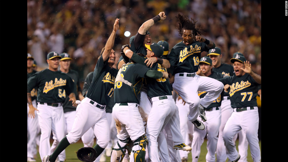 The Oakland Athletics celebrate at the Oakland-Alameda County Coliseum after beating the Texas Rangers Monday night to clinch a playoff spot.