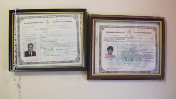 Their certificates of citizenship are hung proudly.