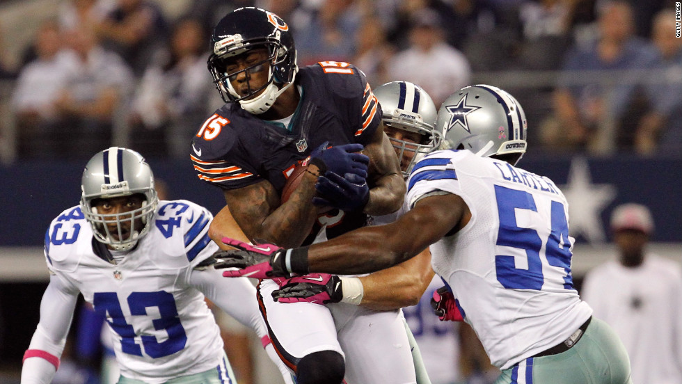 "Brandon Marshall of the Chicago Bears makes a reception for a first down against the Dallas Cowboys on Monday, October 1, in Arlington, Texas. The Bears beat the Cowboys 34-18. <a href=""http://www.cnn.com/2012/09/20/football/gallery/nfl-week-3/index.html"" target=""_blank"">Look back at the best of NFL Week Three.</a>"