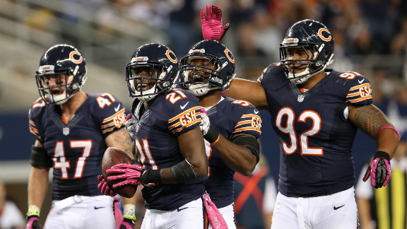 The Bears' Major Wright, No. 21, reacts after he intercepted a pass in the third quarter on Monday.