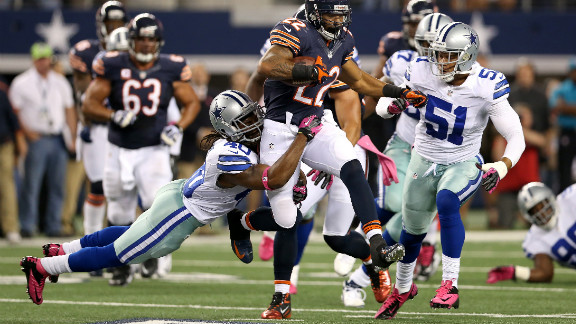 The Bears' Matt Forte runs the ball in the second quarter of Monday's game against the Cowboys' No. 40, Danny McCray.