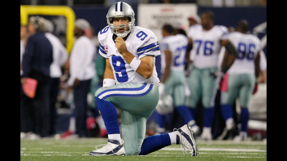 Cowboys quarterback Tony Romo reacts after throwing an interception on Monday.
